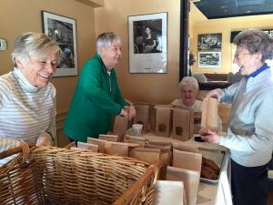 Highlands residents pack up baked treats for patrons of the annual bake sale to take home for the Thanksgiving holiday